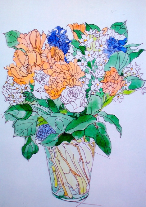Glass vase with flowers.